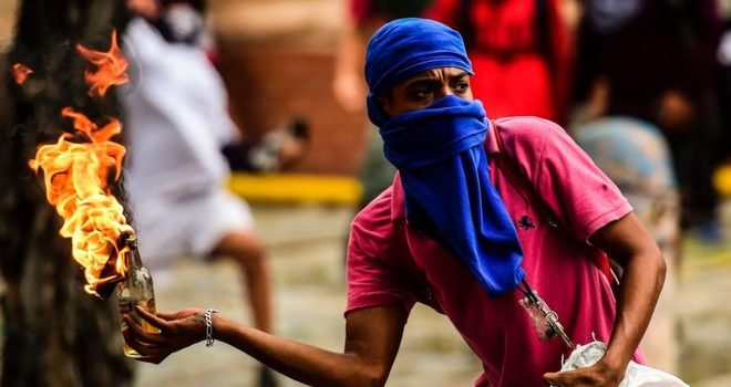 Venezuela crisis: Deadly clashes as millions join strike