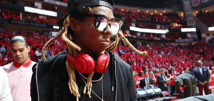 Weezy & LaFlame attend game 2 of the Rockets x Warriors game Wednesday night