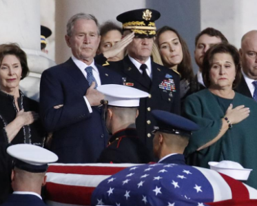 George H.W. Bush saluting the president at state funeral.