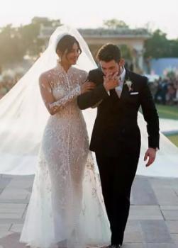 Bollywood star Priyanka Chopra unveils 75-ft long wedding veil.