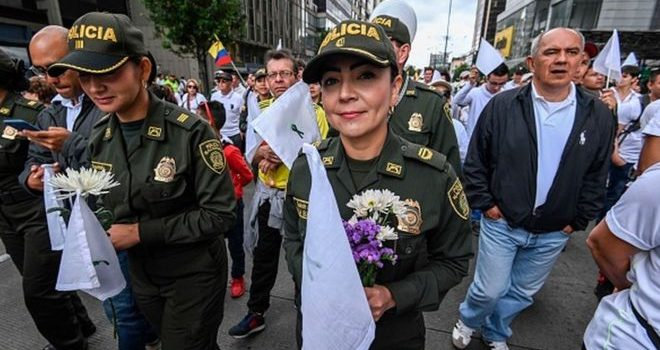 Colombia protest: Thousands march for peace after cadet killings.
