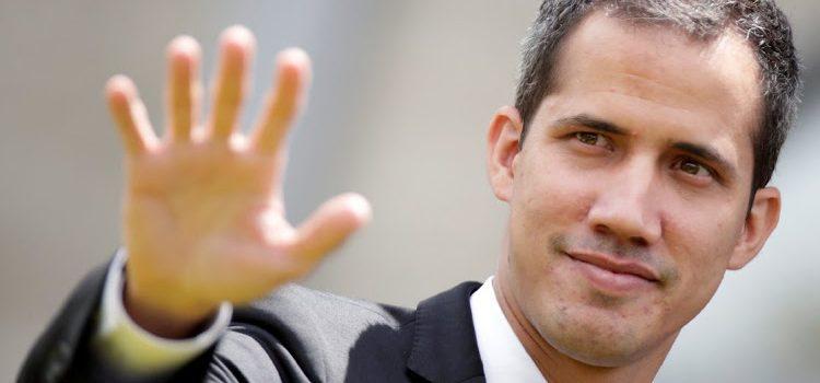 Juan Guaidó flies back to Venezuela despite arrest risk.