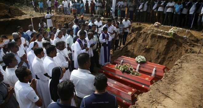 Sri Lanka attacks: Mass funeral on day of mourning.