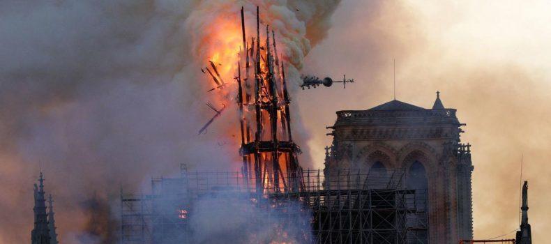 Massive fire ravages Paris cathedral.