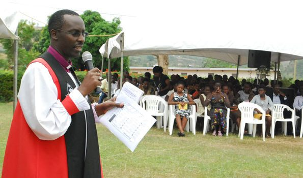 Bishop Sheldon cautions teachers about multi-practice ahead of UNEB AND PLE exams.