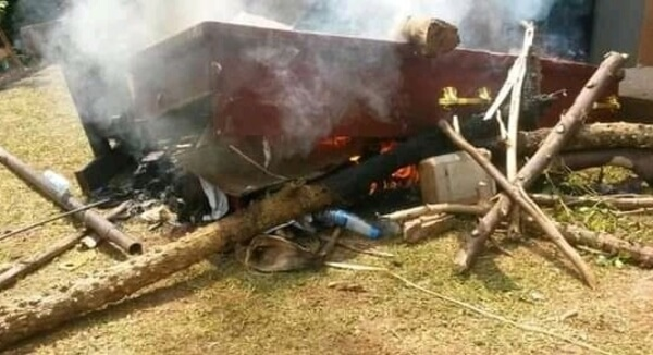 Angry residents burn notorious kidnapper's body and coffin